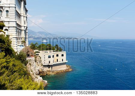 Entrance to Monte Carlo harbor in Monaco as seen from the blue Mediterranean Sea. Horizontal with copy space for text