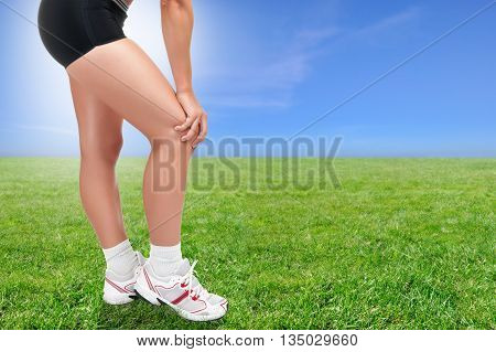 Woman Holding Her Knee In Pain After Running