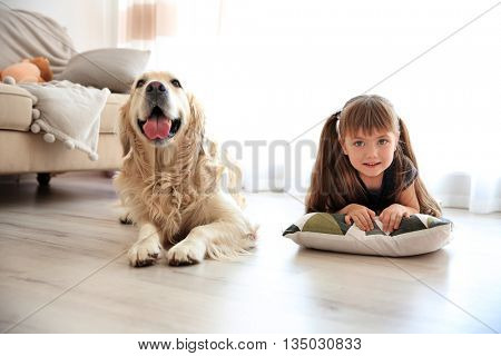 Little girl and big kind dog in the living room