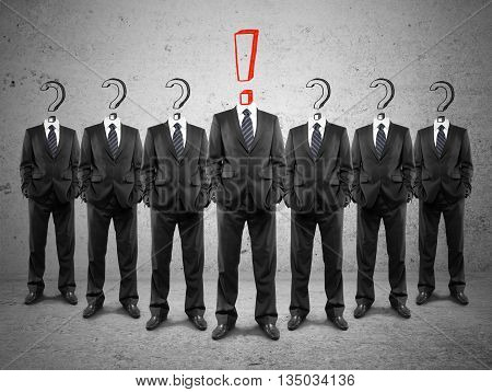 Leadership concept with crowd of businesspeople with question marks and red exclamation mark instead of heads on concrete background
