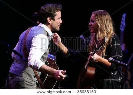 NEW YORK-APR 30: Charles Esten (L) greets Lennon Stella onstage during the 'Nashville' Tour at The Beacon Theater on April 30, 2015 in New York City.