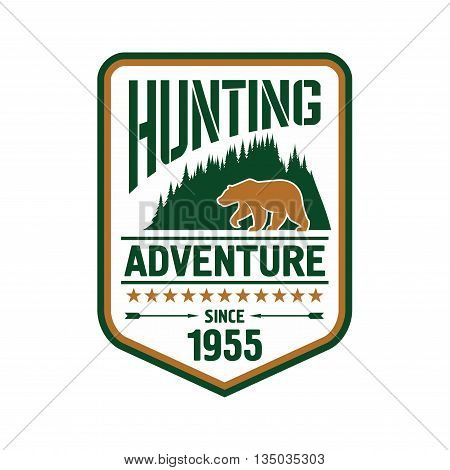 Hunting and outdoor adventure badge design with bear on the front of woody mountains supplemented by stars, arrows and foundation date