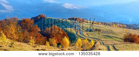 Rural Road On Autumn Mountain Slope.