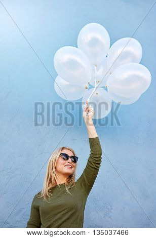 Joyous Young Female Model With Balloons