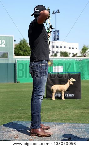 ARLINGTON, TX - APR 18: Recording artist Luke Bryan participates at the ACM & Cabela's Great Outdoor Archery Event at the Texas Rangers Youth on April 18, 2015.
