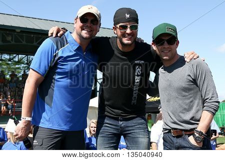 ARLINGTON, TX - APR 18: (L-R) Storme Warren, Luke Bryan and Justin Moore at the ACM & Cabela's Great Outdoor Archery Event at the Texas Rangers Youth Ballpark on April 18, 2015.