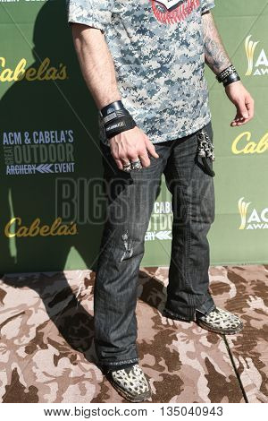 ARLINGTON, TX - APR 18: Jewelry worn by singer Brantley Gilbert at the ACM & Cabela's Great Outdoor Archery Event at the Texas Rangers Youth Ballpark on April 18, 2015.