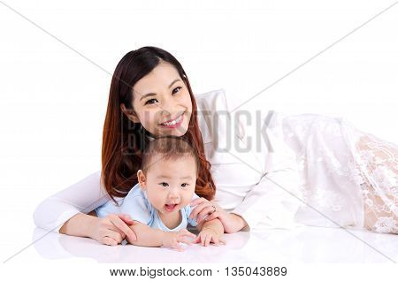 Asian woman and her six months old baby boy lying on the floor