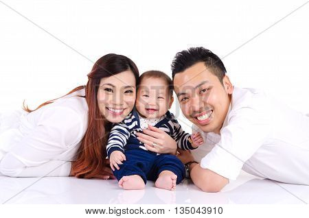 Asian parent and their six months old cheerful baby