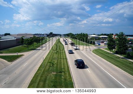 NAPERVILLE, ILLINOIS / UNITED STATES - JULY 23, 2015: A view of the traffic on Highway 59 as seen from the IL 59 Ped/Bike Bridge in Naperville.