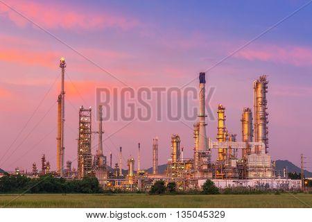 Twilight of oil refinery plant. Oil refinery with twilight skies. Luminosity of oil refinery plant.