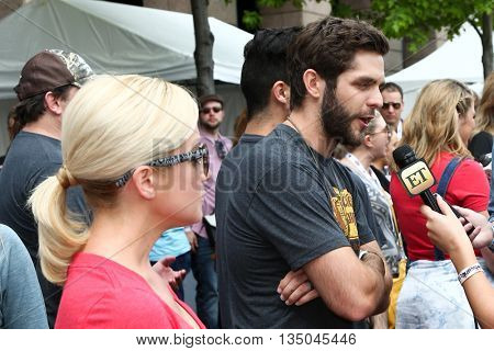 ARLINGTON, TX - APR 18:Kellie Pickler (L) and Thomas Rhett at the Cracker Barrel Old Country Store Country Checkers Challenge at Globe Life Park in Arlington on April 18, 2015 in Arlington, Texas.