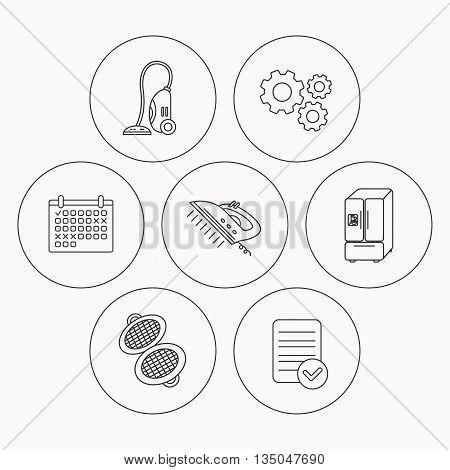 Vacuum cleaner, steam ironing and waffle-iron icons. American style fridge linear sign. Check file, calendar and cogwheel icons. Vector