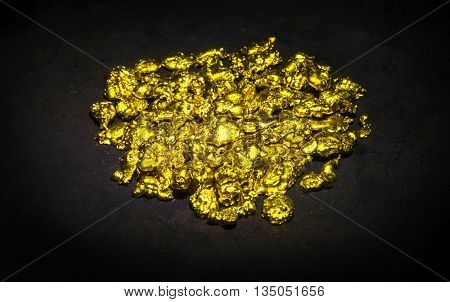 Real golden nuggets isolated on black background.