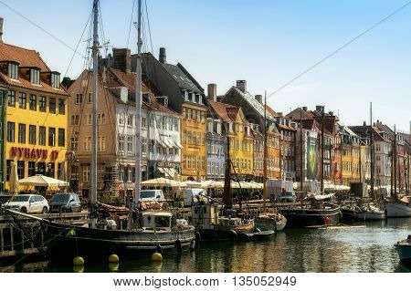 Copenhagen Denmark - May 10 2016 - Nyhavn harbour with its colorful houses in the danish capital Copenhagen. Nyhavn is a popular tourist destination.