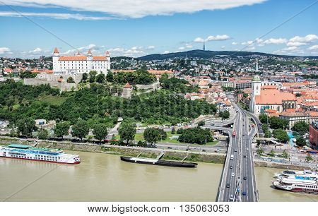 Bratislava is the capital city of Slovak republic. Beautiful castle Saint Martin's cathedral bridge SNP Danube river and Kamzik TV Tower. Architectural theme. Travel destination. Cultural heritage.