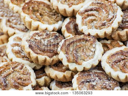 Tasty cookies with caramel cream filling and sugar sprinkles. Food theme. Refreshments for guests. International cuisine.