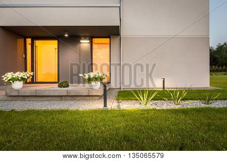 Contemporary house with garden and decorative outdoor lighting external view
