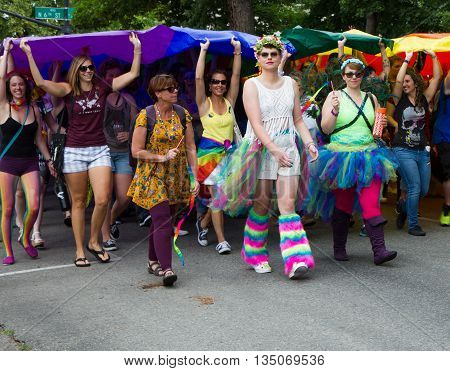 BOISE IDAHO/USA - JUNE 20 2016: in support of the LGBT community people march together during the parade at Boise Pridefestival