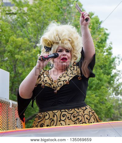 BOISE IDAHO/USA - JUNE 20 2016: Person on their float during the Boise Pridefestival talking to the crowd
