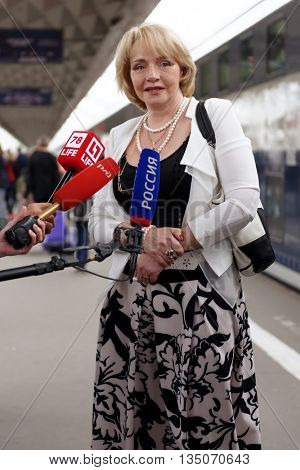 ST. PETERSBURG, RUSSIA - MAY 28, 2016: President of the Mikhail Ulyanov's foundation Elena Ulyanova talks with press at the double-decker train Mikhail Ulyanov in the day of its first departure
