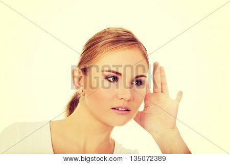 Shocked young woman overhears conversation