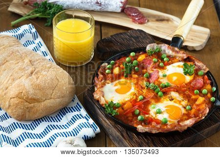 Huevos a la Flamenca or Flamenco Eggs. Eggs poached in tomato sauce