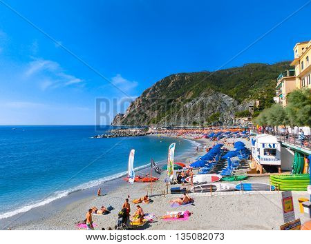MONTEROSSO, ITALY - SEPTEMBER 09, 2015: People on the coastline of Monterosso in Italy. Monterosso is one of five famous coastline villages in the Cinque Terre National Park.