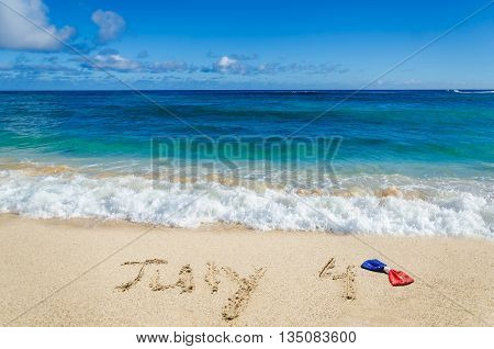 Independence Day USA background with holidays bow on the sandy beach (4th of july holiday concept)