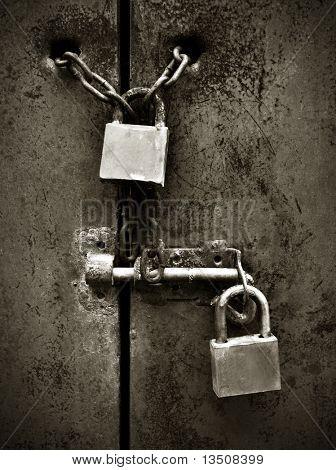 locks on rusty metal door
