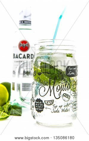 SWINDON UK - JUNE 20 2016: Classic Mojito cocktail in a Kilner Mason Jar with a bottle of Bacardi isolated on a white background