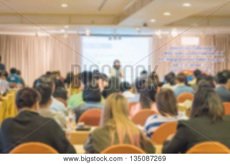 Motion blur of view of seminar with audience in a seminar room