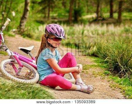 Bicycle girl. Girl rides bicycle. Girl in bicycle sitting near bicycle. Bicycle is good for health and mood. Bicycle girl looking into distance.