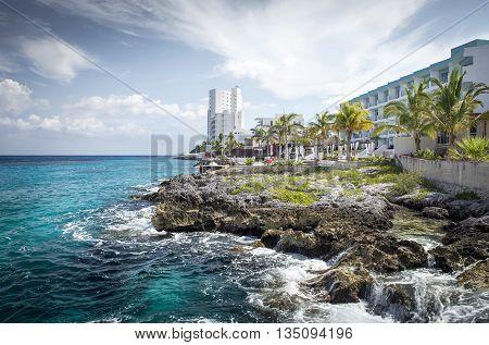 Coast of Cozumel island with waves crushing on rocks, Mexico