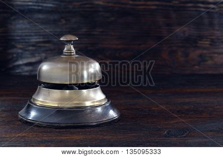 Bell on the hotel reception old desk