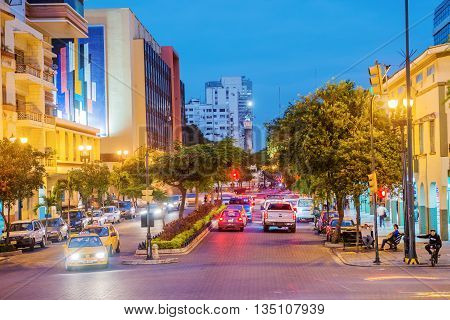 Guayaquil Ecuador - April 15 2016: Night view at the traffic a on the street leading to monument to the Ecuador independence heroes in Guayaquil Ecuador.