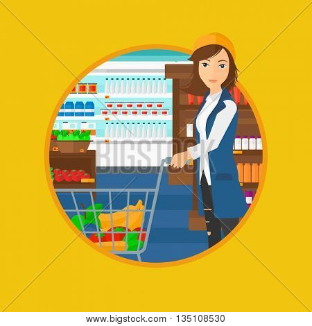 Young woman pushing a supermarket cart with some goods in it. Customer shopping at supermarket with cart full with groceries. Vector flat design illustration in the circle isolated on background.