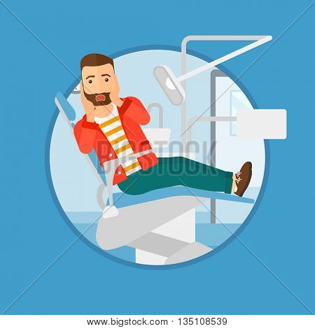 Frightened hipster patient with the beard at dentist office. Scared young man in dental clinic. Afraid man sitting in dental chair.Vector flat design illustration in the circle isolated on background.