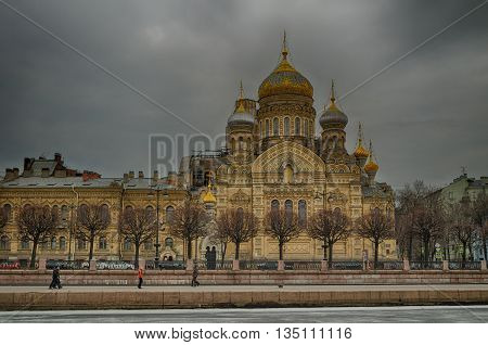ST PETERSBURG RUSSIA - MARCH 2 2014. Architecture view of Assumption Church on Vasilevsky Island in St Petersburg architecture landscape in cloudy weather. View of architecture landmark of St Petersburg