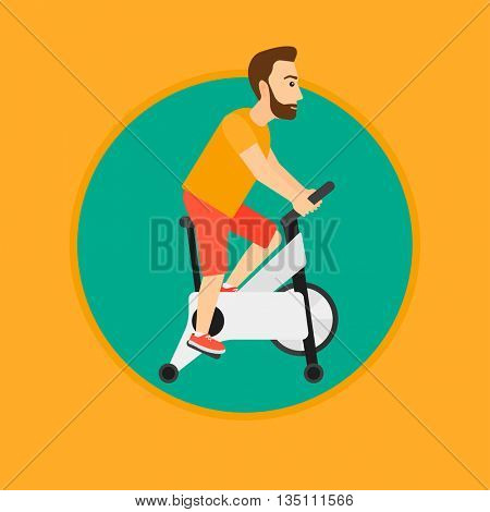 A hipster man riding stationary bicycle. Sporty man exercising on stationary training bicycle. Man training on exercise bike. Vector flat design illustration in the circle isolated on background.