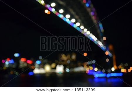 Bokeh with yellow, blue and purple colors, Night city lights bokeh background, Defocused bokeh lights, Blurred bokeh, Bokeh light vintage background, Abstract colorful defocused dot, Soft focus. Bokeh Harbour Bridge.