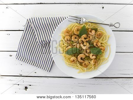 Chilli prawn linguine on retro white wooden table background