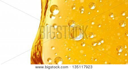 Wave vertical from yellow liquid with air bubbles for oil honey beer or other variants area for text on white background