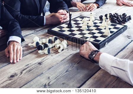Business people playing chess business competition concept