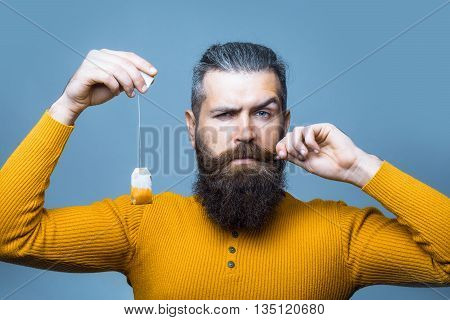 Bearded Serious Man With Tea Bag