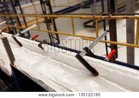 ST. PETERSBURG, RUSSIA - MAY 24, 2016: Making the hull of the passenger catamaran of the project 23290 from composites at Sredne-Nevsky shipyard. The shipyard started producing such catamarans in 2013