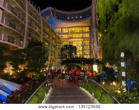 Barselona, Spaine - September, 6 2015: Royal Caribbean, Allure of the Seas sailing from Barselona on September 6 2015. The second largest passenger ship constructed behind sister ship Oasis of the Seas. Passengers walking along Central Park at night