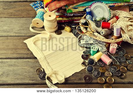 Blank form for writing text on background tailor accessories. Selective focus.