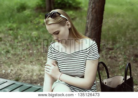 Sad Young Woman In A Striped