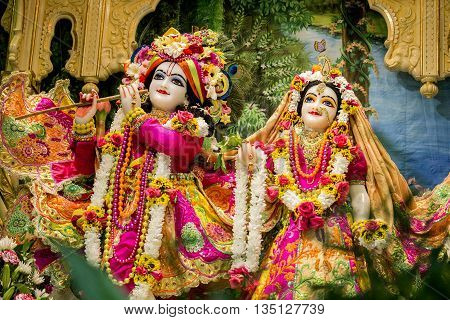 Durban, South Africa - March 20, 2016: Hindu God Krishna with his wife Radha. Bright colorful sculptural composition. Artistic retouching.